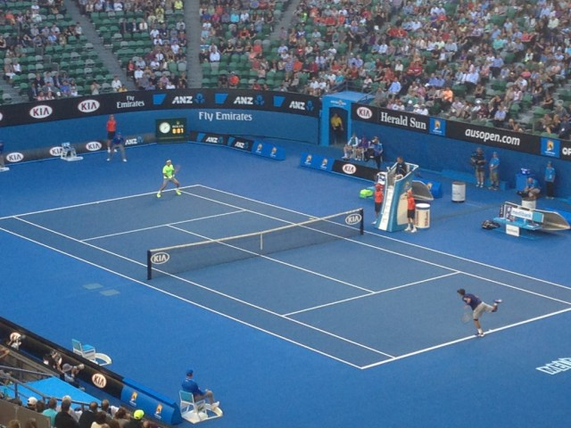 Federer in action! I don't think he even needed to warm up! Won in straight sets.