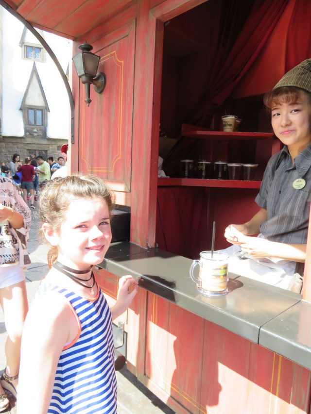 Getting our frozen Butter Beer, it's very sweet.