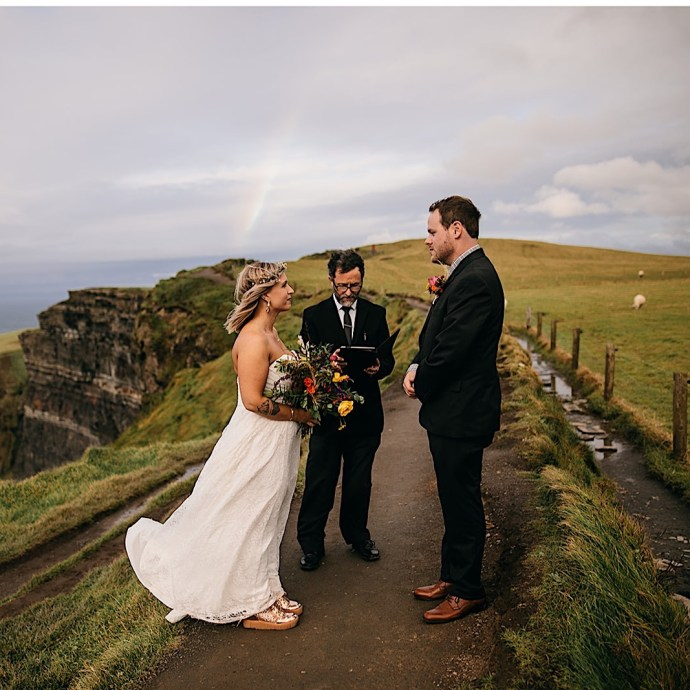 Wedding on the Cliffs of Moher in Ireland with a rainbow