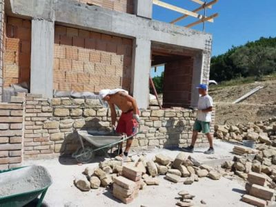 Adding Stone Near the Study on a new stone house in Le Marche