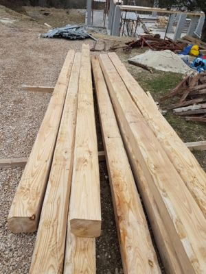Chestnut ceiling beams delivered to new house construction site in Le Marche