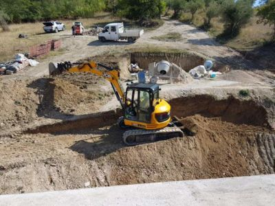 Digging Out the Slope in Front of a new house being built in Le Marche, Italy