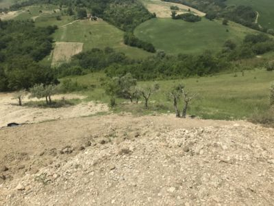 Down the Problem Back Slope  at site of a new house being built in Le Marche, Italy