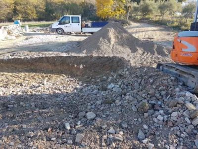 Extending the Fill in front of a new house being built in Le Marche, Italy