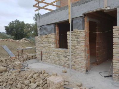 Front Near Study showing stone work on a new house in Le Marche