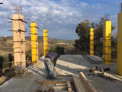 Plywood Exterior Being Removed from Column at new house construction site in Le Marche