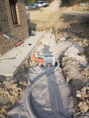 Laying Waste Lines on Side at new house construction site in Le Marche