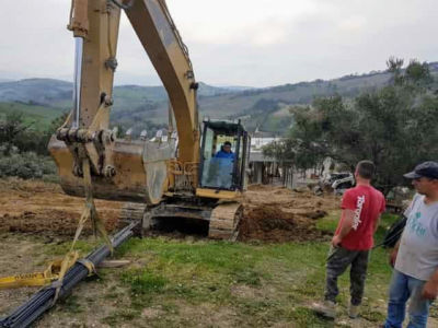 Lifting the Steel as part of house construction project in Le Marche