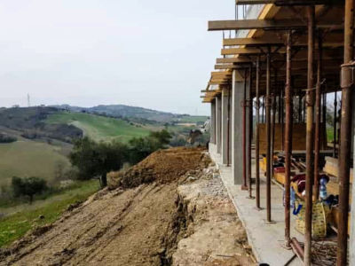 Moving Soil to Back of House as part of house construction project in Le Marche