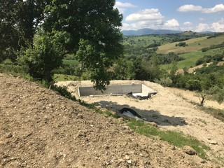 Pool in Front of Mountains  at site of a new house being built in Le Marche, Italy