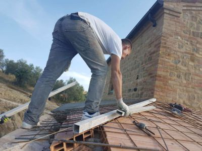 Preparing a Roof Joint at a new building site in Le Marche, Italy