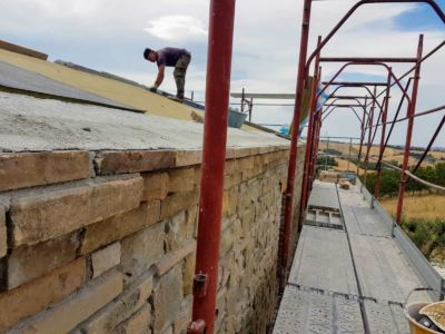 Work on the Roof of a new house being built in Le Marche, Italy