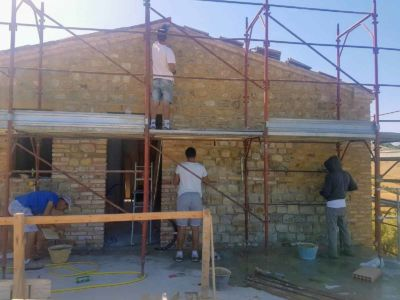 Working on Terrazza Wall of a new house being built in Le Marche