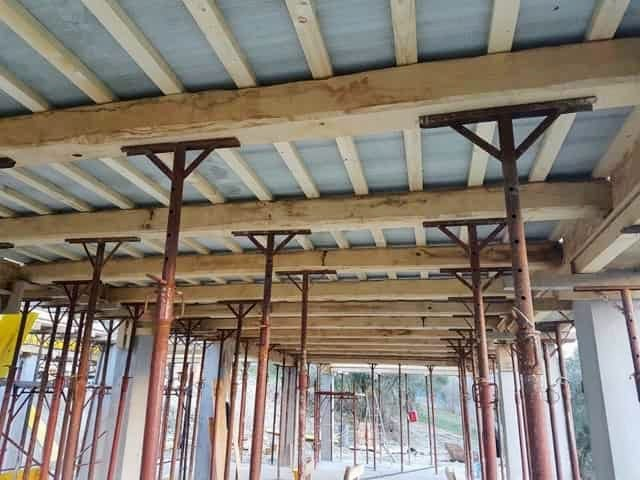 Ceiling underpayment composite panels above beams