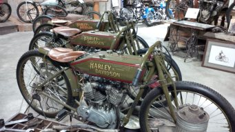 A trio of very old Harley Davidsons.