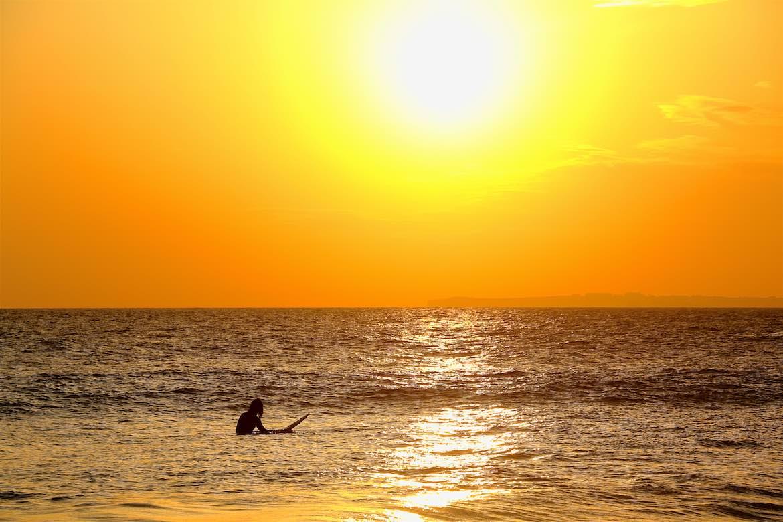 Surfer at Praia de Cabanas.