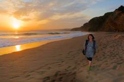 Joanne takes a sunset stroll at Praia de Cabanas.