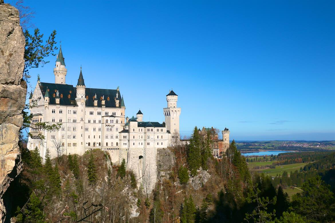 Neuschwanstein castle overlooks the land.