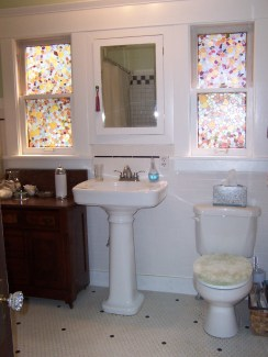 Bath windows with patterned privacy film