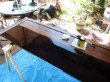 Dark walnut stain applied to African mahogany footboard