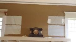 Wall showing detached plaster outlined in felt pen