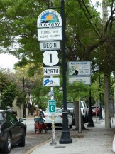 Pole with highway signs and US 1 mile marker 0 in Key West, FL