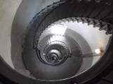 Looking down spiraled lighthouse stairs