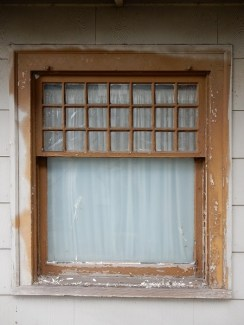 Multipaned window with peeling paint