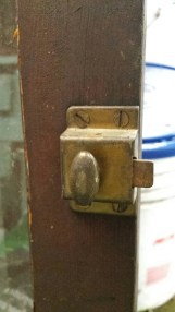 Antique brass latch on old cabinet door