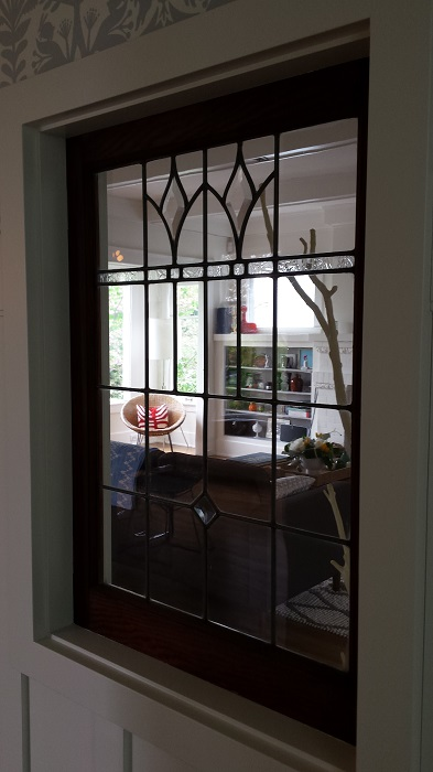 Great way to save a window: leaded glass peek-through.