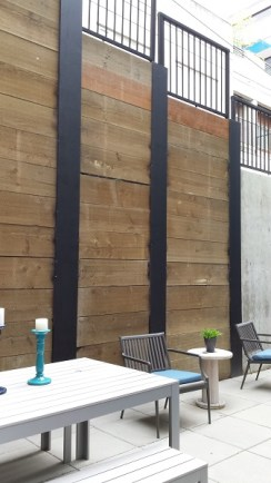 Deep courtyard lined with timber retaining wall