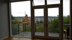 French doors to a deck off the dining area show a view to the west in Seattle.