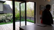 View out glass doors to backyard deck