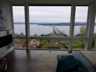 Living room window wall and view of I-90 and Lake Washington