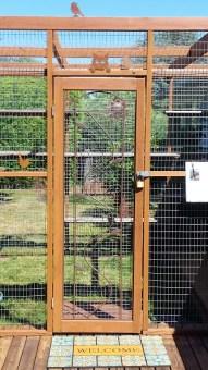 Catio door with decorative iron vine design
