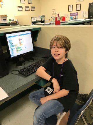 Jacob shows off his school computer