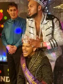 Outgoing Mr. Southbend 2017, Isaac Ismael, crowns the new Mr. Southbend 2018, Adonis Vayne. Contestant Draco DK looks on in the background. [Southbend Tavern - Columbus, Ohio on March 25th, 2018]