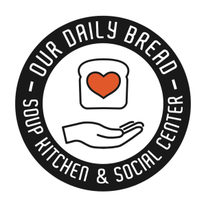 Round button with a piece of bread with a heart in the center above an open hand- around the outside, the pin reads Our Daily Bread Soup Kitchen and Social Center