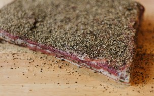 Fully cured; thoroughly coated in cracked black pepper