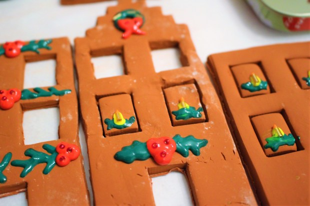 Decorated clay ginger bread house process