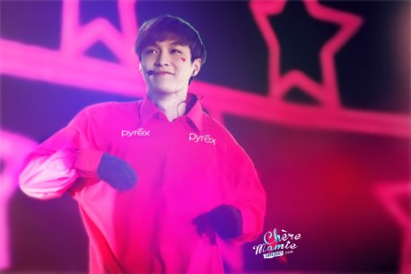 Yixing in a red shirt and black gloves