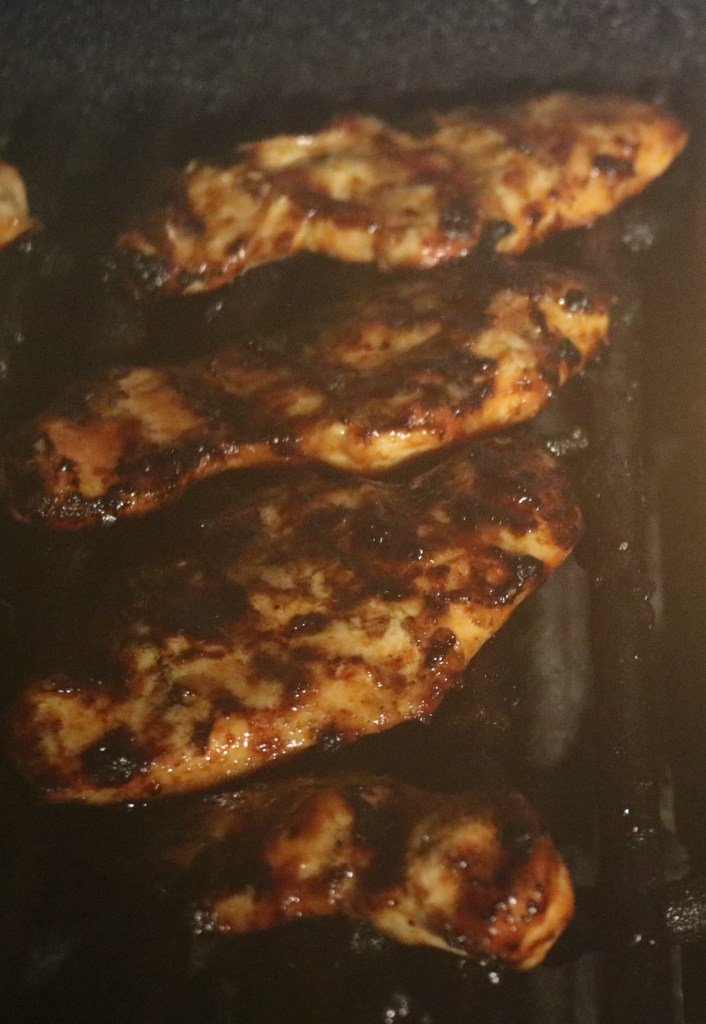 Marinated chicken grilling