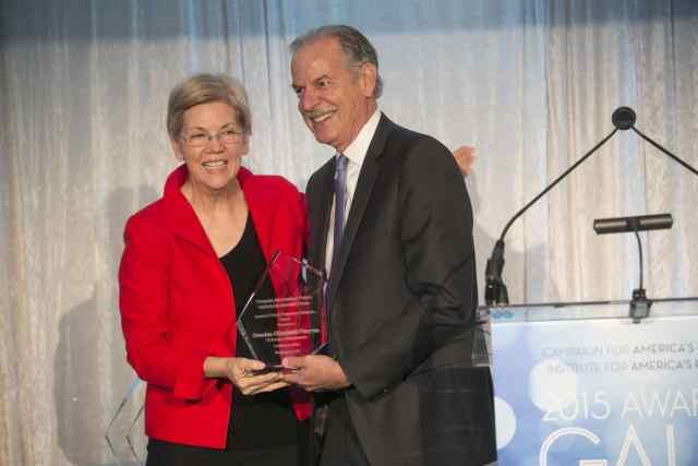 Sen. Elizabeth Warren (D-Mass.) receives the  Campaign for America's Future Progressive Champion Award from organization co-director Robert Borosage at the CAF 2015 Awards Gala. Photo © Dennis Drenner.