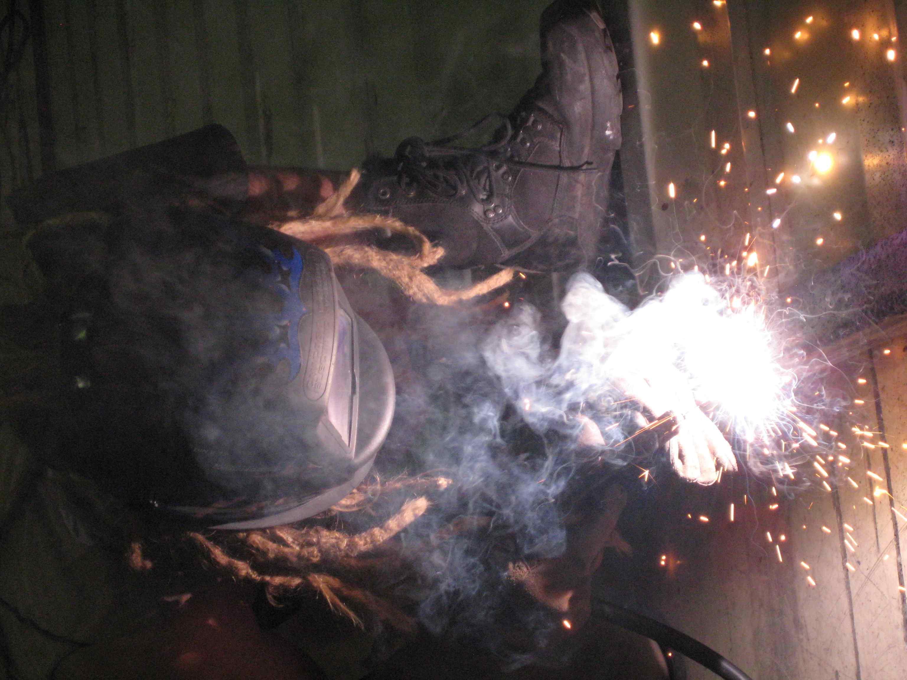 Kokopaullie (of Sew Ops) welding the new floors