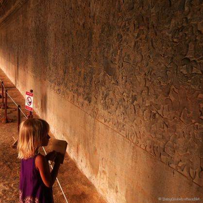 Miss Z taking notes on the intricate inscriptions at Angkor Wat