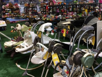 Baby swings and rockers are popular items.