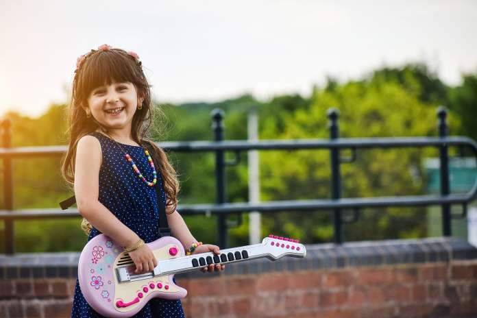 Mothers day 2020 -Little Happy Girl Playing Guitar-min