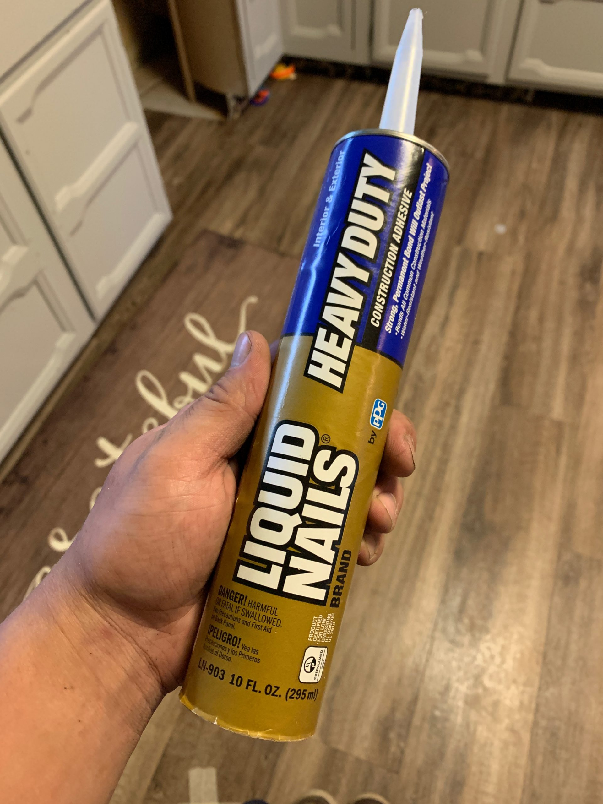liquid nails- used to glue on shiplap to the wall.