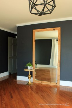 Framed-Wall-Mirror-Finishsed-in-Master-Bedroom