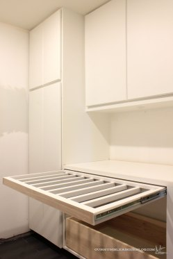 Add drying rack drawers to a laundry room: https://ourhumbleabodeblog.com/2016/05/26/laundry-room-progress/